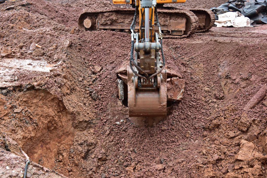 Boden, Bodenmanagement, Bodenuntersuchungen, DTCOM, Knopf zu Dr. Peter Dreschmann